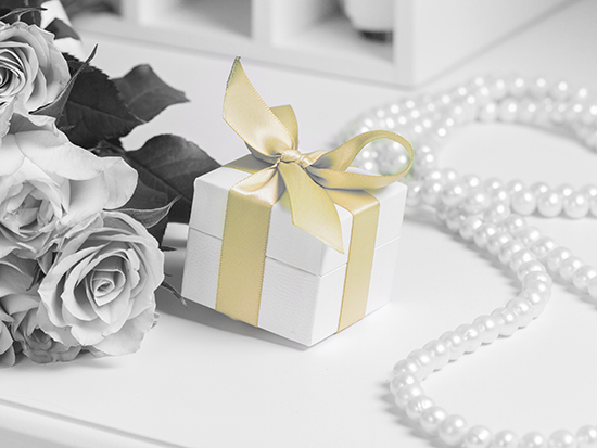 Giftwrapped Package with Gold Bow Ribbon